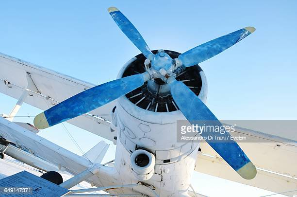 low angle view of airplane at airport - propeller stock pictures, royalty-free photos & images