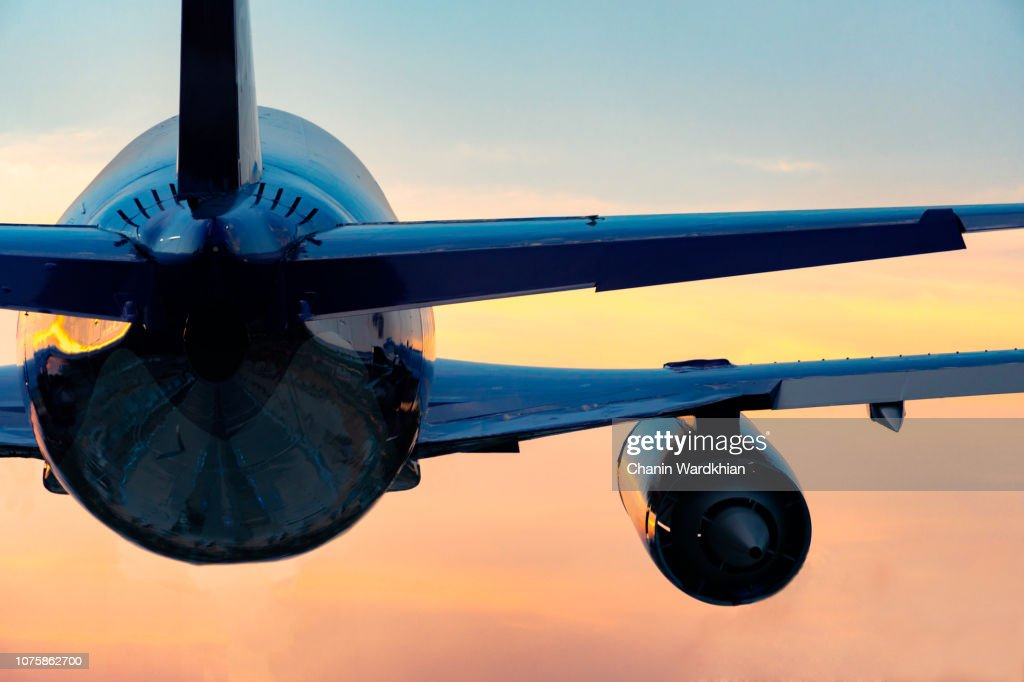 Low Angle View Of Airplane Flying Against Sky During Sunset : Stock Photo