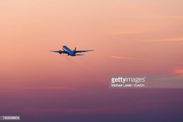 low angle view of airplane flying in the sky - airplane sky stock pictures, royalty-free photos & images
