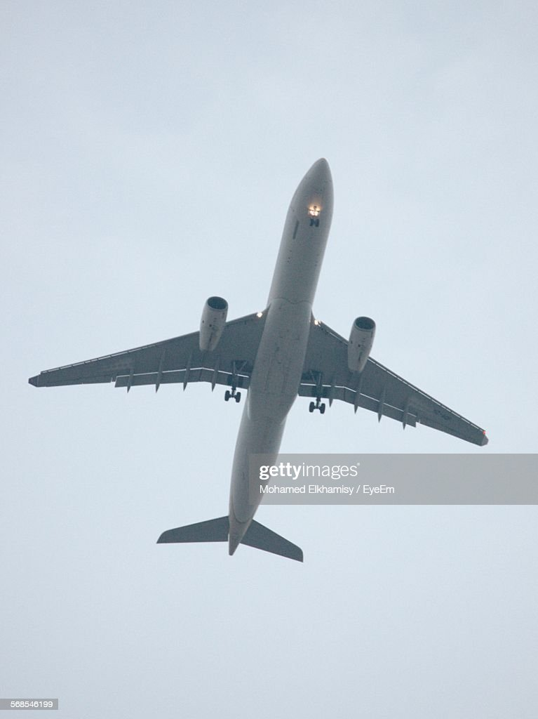 Low Angle View Of Airplane In Clear Sky : Stock Photo