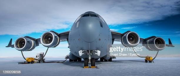 low angle view of airplane on airport runway against sky - オーストラリア軍 ストックフォトと画像