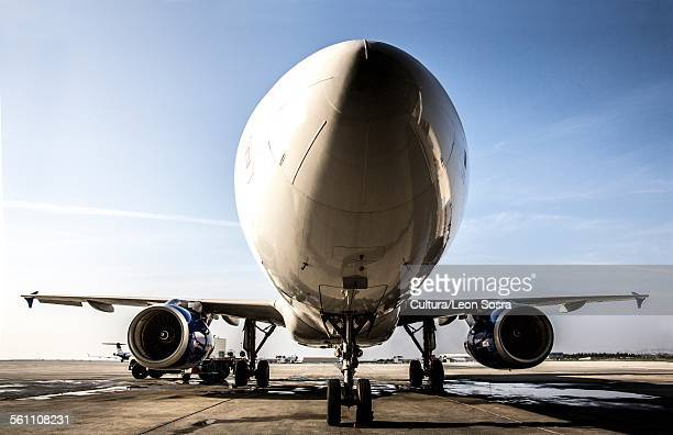 Low angle view of airplane on tarmac at airport