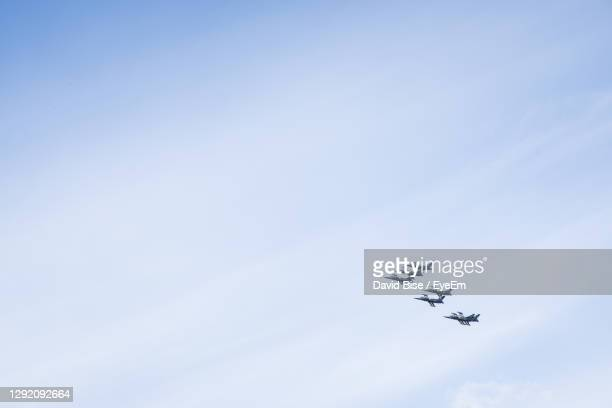 low angle view of airplanes against sky - blue angels stock pictures, royalty-free photos & images