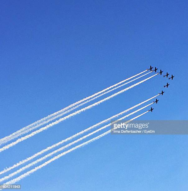 Low Angle View Of Airplanes During Airshow Against Clear Sky