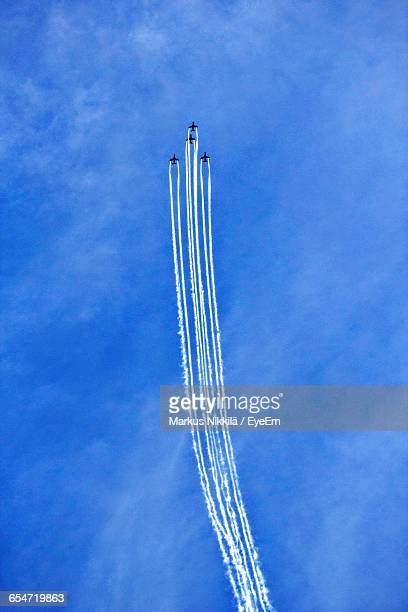 Low Angle View Of Airplanes Flying Against Sky During Airshow