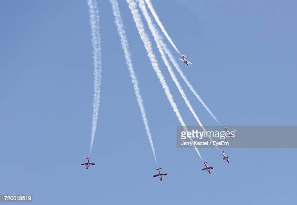 Low Angle View Of Airplanes Flying In Sky