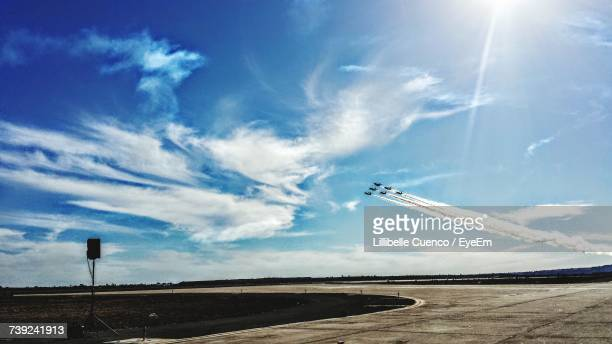 low angle view of airplanes flying over landscape - cuenco stock photos and pictures