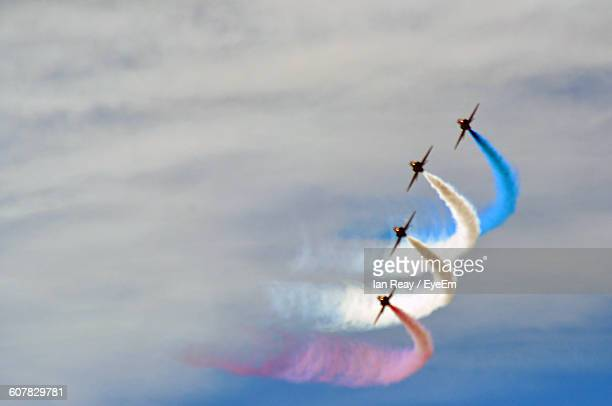 Low Angle View Of Airplanes Performing Air Show Against Sky