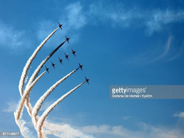 low angle view of airshow in sky - arrangement stock pictures, royalty-free photos & images