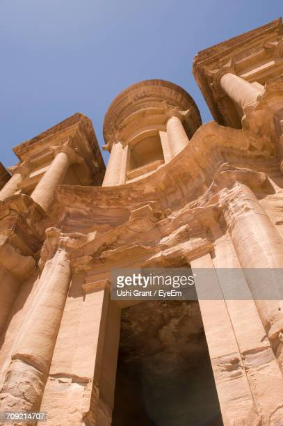 Low Angle View Of Al Deir Temple Against Clear Sky