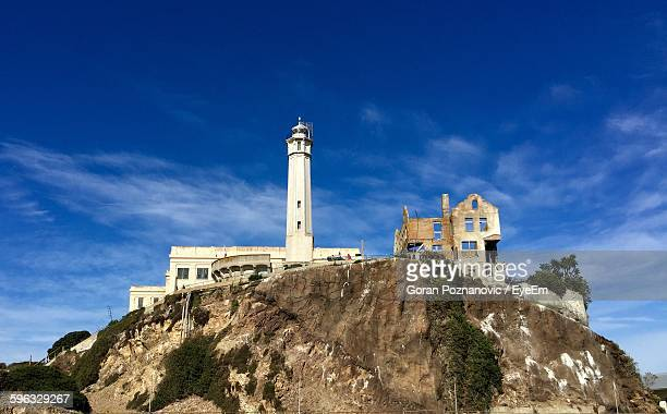 Low Angle View Of Alcatraz Island Lighthouse Against Blue Sky