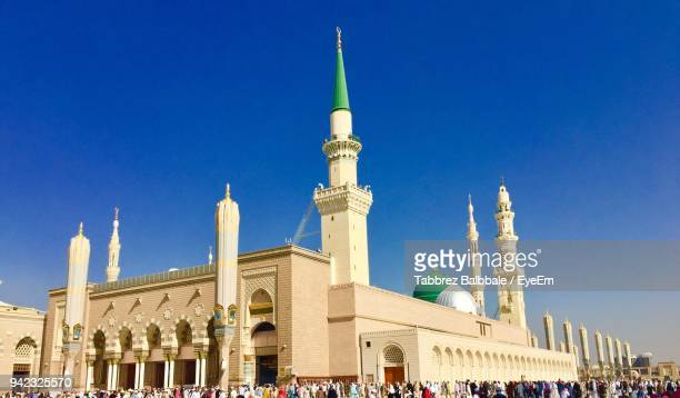 low angle view of al-masjid an-nabawi against blue sky - al masjid al nabawi stock pictures, royalty-free photos & images