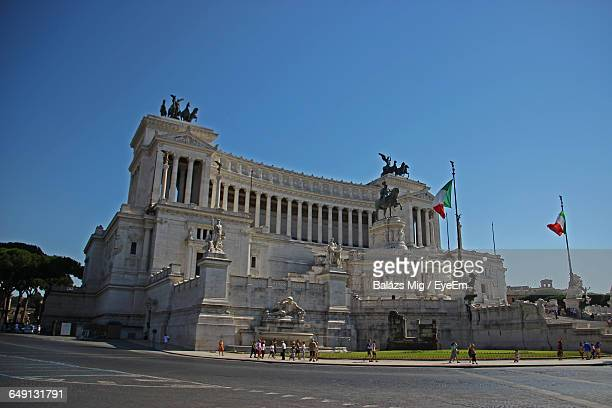 Low Angle View Of Altare Della Patria Against Clear Blue Sky