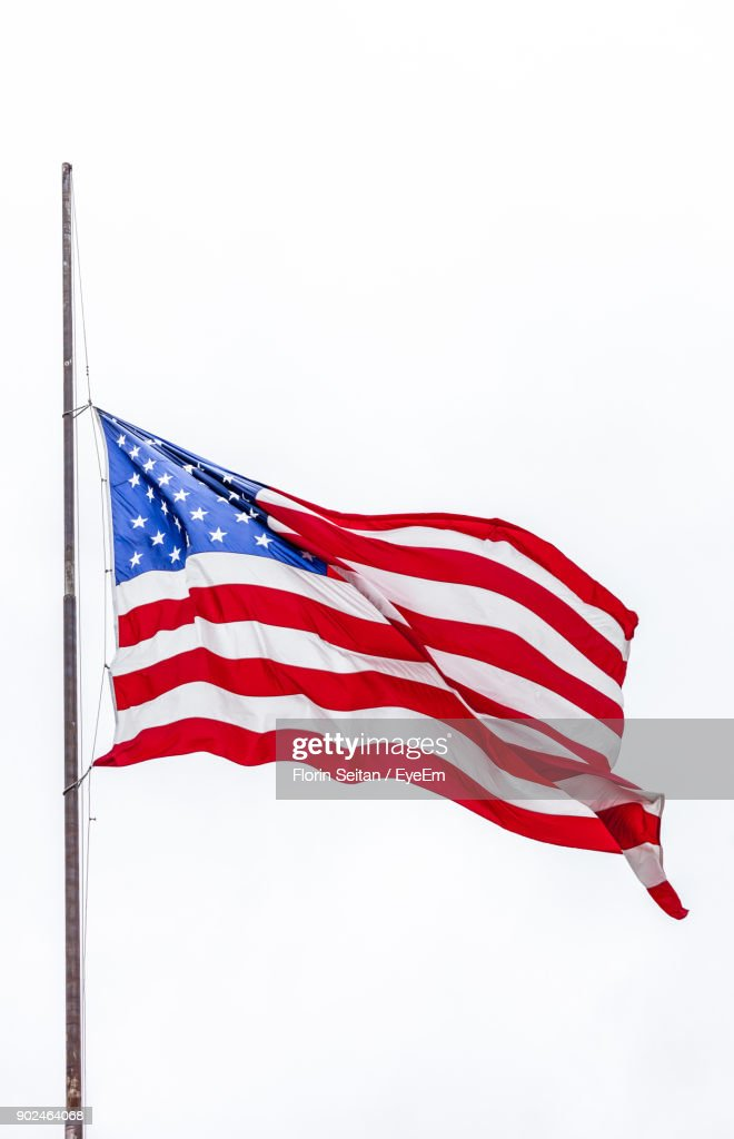 Low Angle View Of American Flag Against Clear Sky : Stock Photo