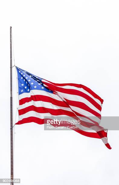low angle view of american flag against clear sky - florin seitan stock pictures, royalty-free photos & images