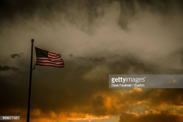 low angle view of american flag against orange sky - dave faulkner eye em stock pictures, royalty-free photos & images