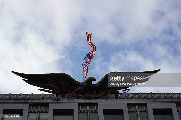 Low Angle View Of American Flag And Bald Eagle Statue On Us Embassy