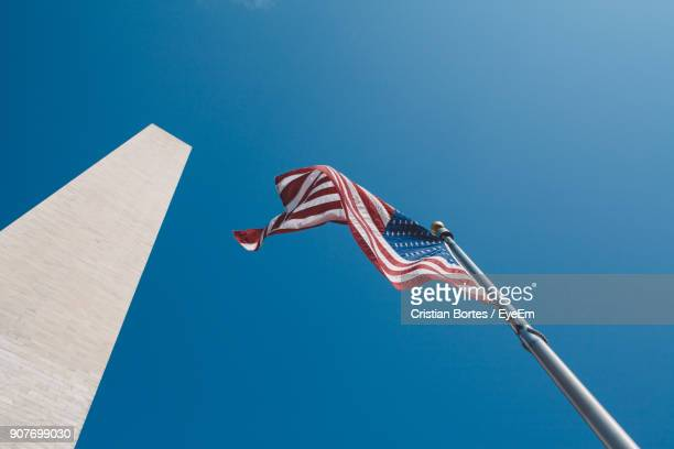 Low Angle View Of American Flag Fluttering Against Clear Blue Sky