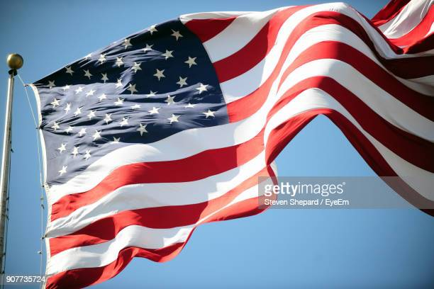 Low Angle View Of American Flag Fluttering Against Clear Sky