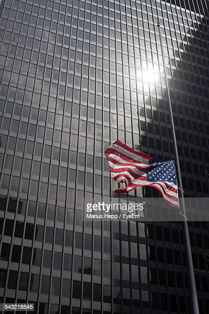 low angle view of american flag outside willis tower - half mast stock photos and pictures