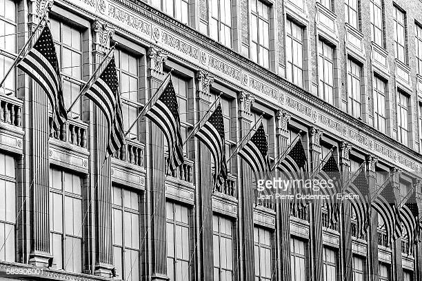 Low Angle View Of American Flags On Government Building