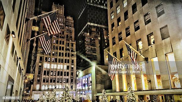 Low Angle View Of American Flags On Illuminated Building During Christmas