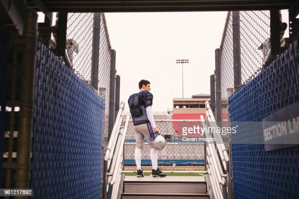 low angle view of american football player standing at stadium seen through entrance - safety american football player stock pictures, royalty-free photos & images