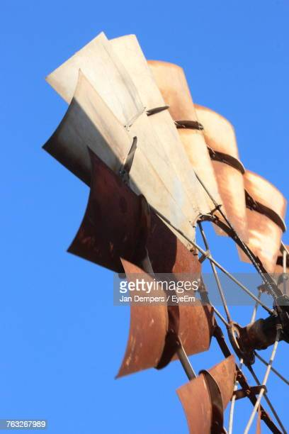 low angle view of american-style windmill against clear blue sky - american style windmill stock pictures, royalty-free photos & images