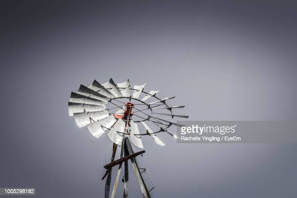 low angle view of american-style windmill against clear sky - american style windmill stock pictures, royalty-free photos & images
