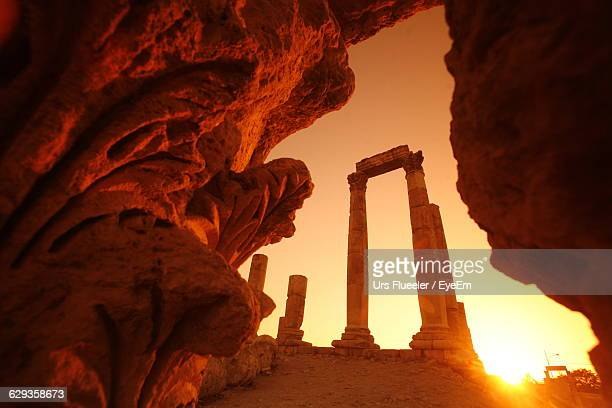 low angle view of amman citadel seen from cave against sky during sunset - jordan middle east stock pictures, royalty-free photos & images