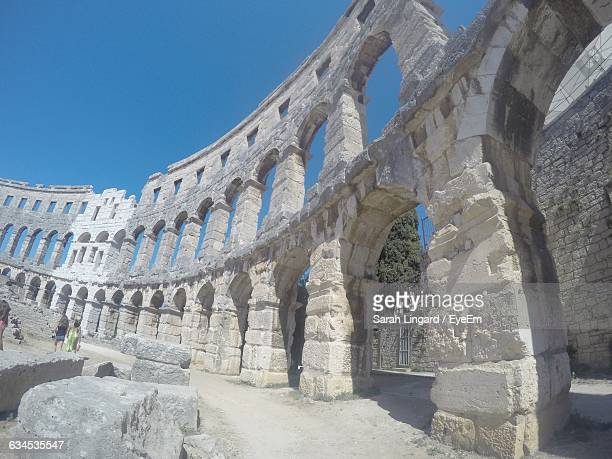 low angle view of amphitheater against blue sky on sunny day - lingard stock photos and pictures