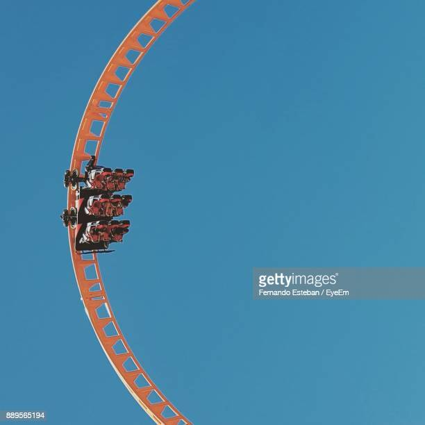 low angle view of amusement park ride against clear sky - coney island stock pictures, royalty-free photos & images