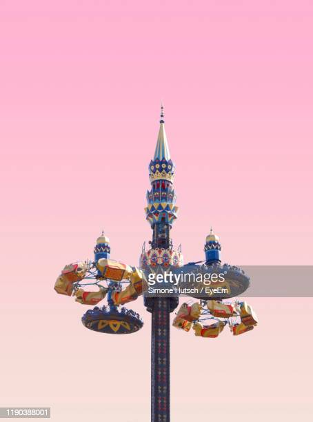 low angle view of amusement park ride against colored background - 遊園地の乗り物 ストックフォトと画像
