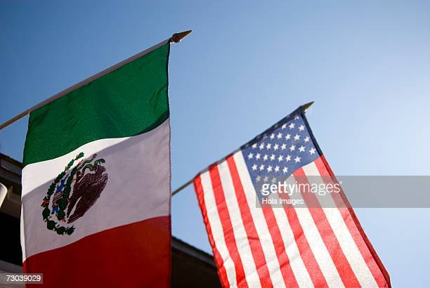 low angle view of an american flag and a mexican flag - bandera mexicana fotografías e imágenes de stock