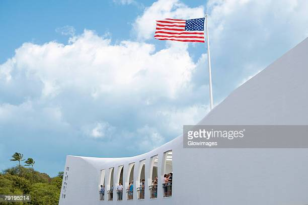 low angle view of an american flag fluttering on a memorial building, uss arizona memorial, pearl harbor, honolulu, oahu, hawaii islands, usa - pearl harbor stock pictures, royalty-free photos & images