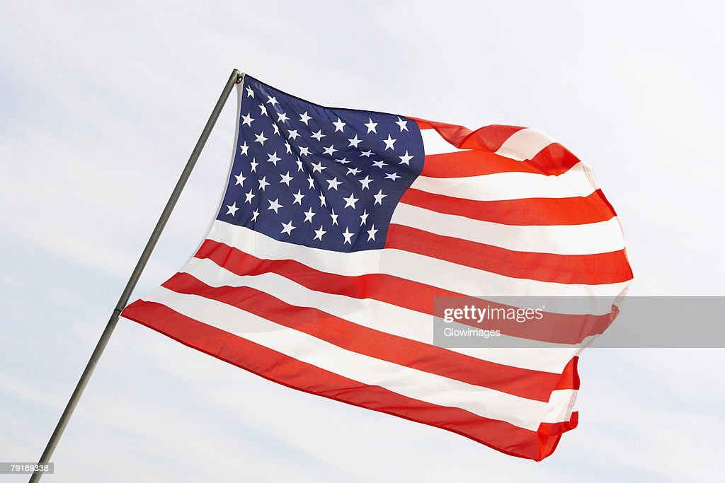 Low angle view of an American flag fluttering, USA : Foto de stock