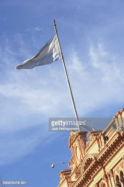Low angle view of an Argentinean flag fluttering on the top of a building
