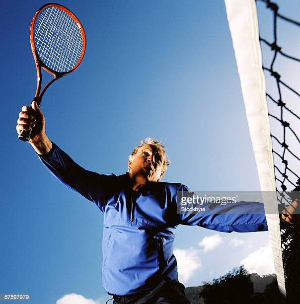 Low angle view of an elderly man playing tennis