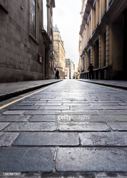 low angle view of an empty street in the city of london during lockdown - economic stimulus stock pictures, royalty-free photos & images