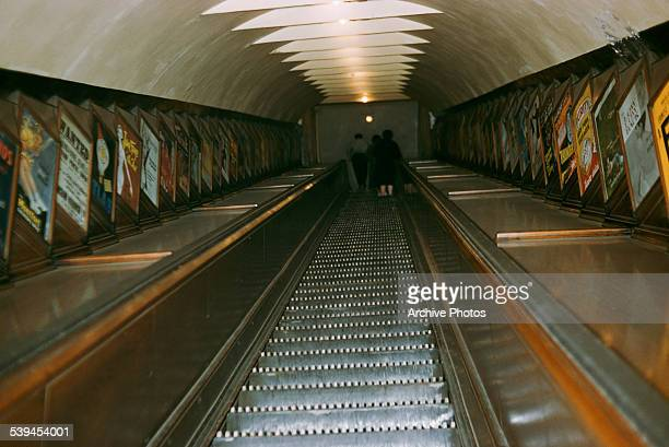 A low angle view of an escalator in a London Underground station London England circa 1960