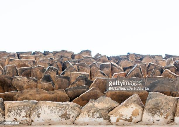 Low angle view of an old traditional building with stones protecting adobe from the rain Asir province Abha Saudi Arabia on January 16 2010 in Abha...