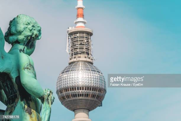 Low Angle View Of Angel Statue Against Fernsehturm