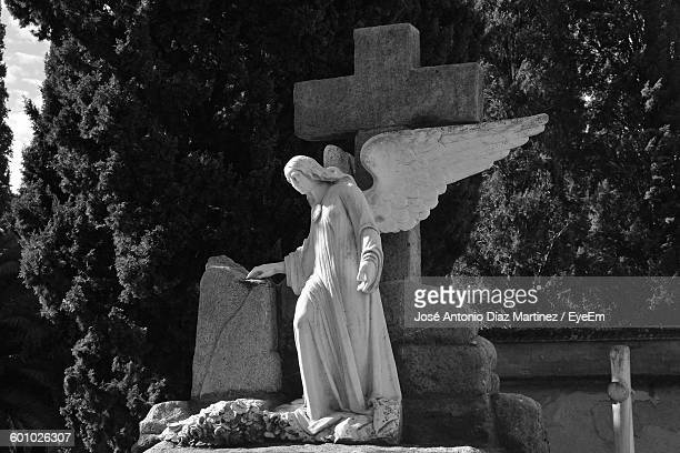 Low Angle View Of Angel Statue At Cemetery