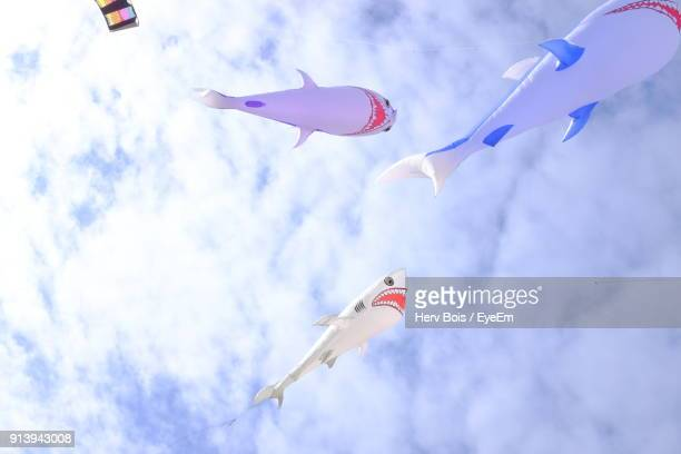 Low Angle View Of Animal Balloons Flying Against Sky