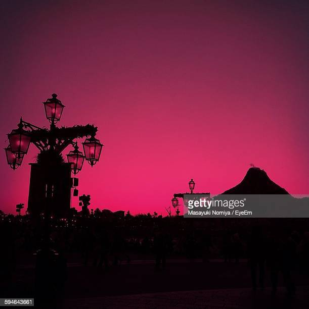 Low Angle View Of Antique Lanterns Against Pink Sky