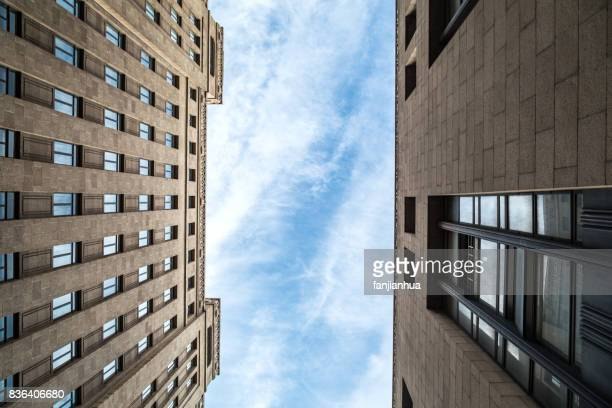 low angle view of apartment against blue sky