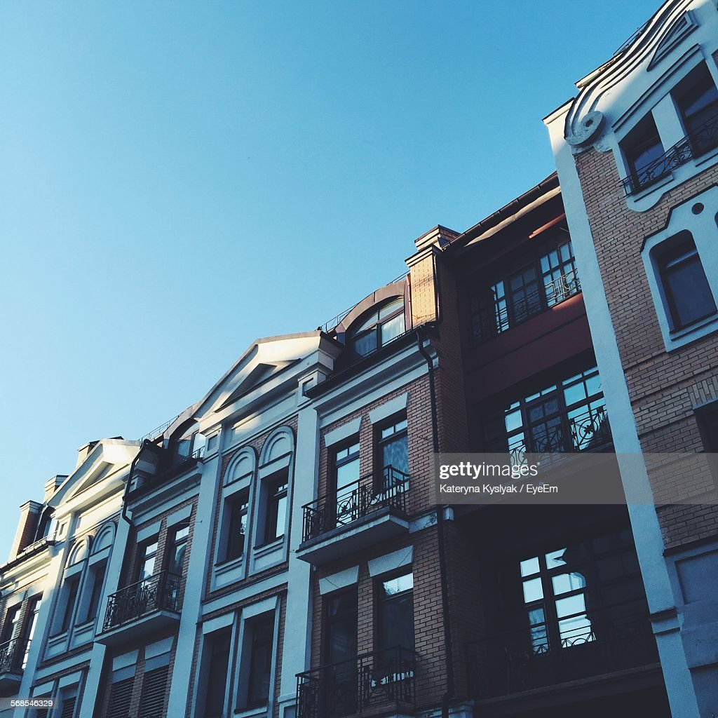Low Angle View Of Apartment Building Against Clear Sky : Stock Photo