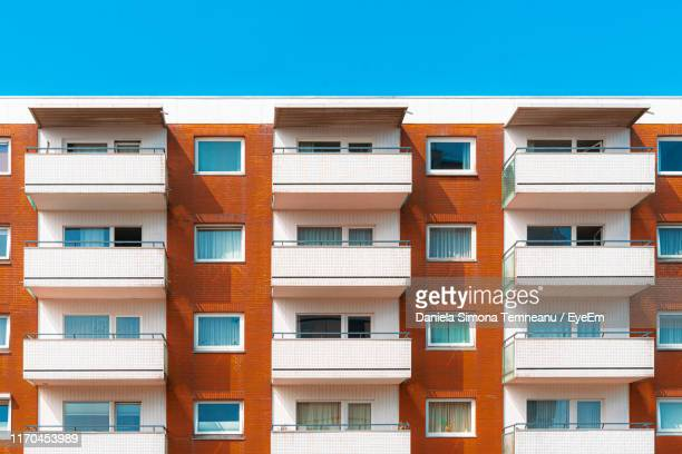 low angle view of apartment building - balcony stock pictures, royalty-free photos & images
