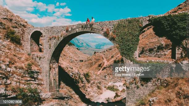 low angle view of arch bridge against sky - albania stock-fotos und bilder