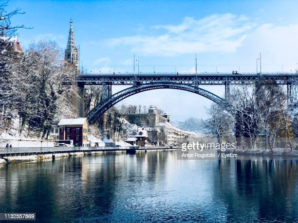 low angle view of arch bridge over river against sky - bern stock pictures, royalty-free photos & images